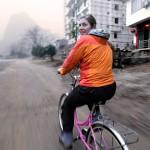 Ann on bike beautifully blurry